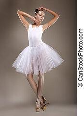 Ballet. Graceful Ballerina in White Light Tutu - Performance. Fantasy