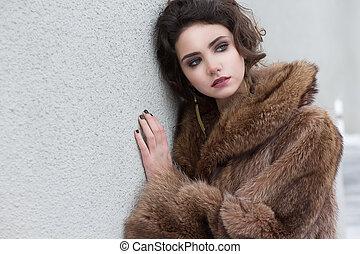 Loneliness. Winter. Beautiful Refined Female in Wool Fur...