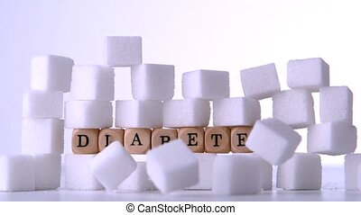 Sugar cubes falling in front of dice spelling out diabetes...