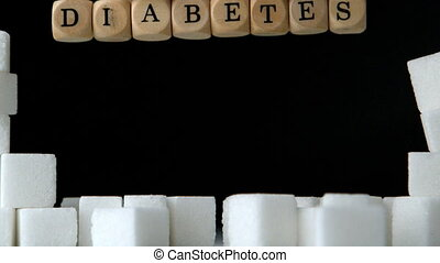 Sugar cubes and dice spelling diabetes falling down in black...