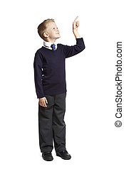 School boy pointing up - 8 year old school boy pointing up...