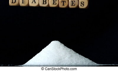 Dice spelling diabetes falling over a pile of sugar in slow...