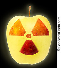 Nuclear danger - Yellow apple on black background with sign...
