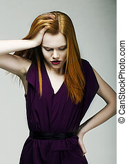 Sadness. Unhappy Woman holding her Red Head with hand in...
