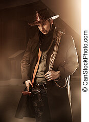 handsome man in cowboy clothes - Young adult handsome man in...