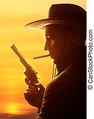 vaquero, sombrero, cigarro, revólver