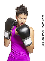 Young woman boxing in sports outfit - Young woman with...