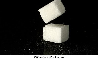Sugar cubes falling on hard surface