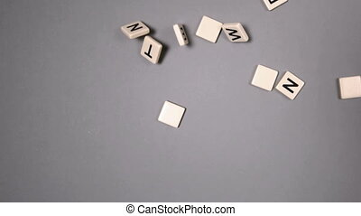 Plastic letters bouncing and spelling out networking in slow...