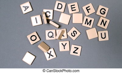 Plastic letters bouncing and showing the alphabet in slow...