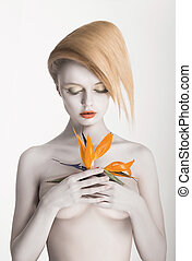 Bodypainting. Enigmatic Gorgeous Woman with Strelitzia...