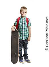 School boy with skateboard - 8 year old school boy with...