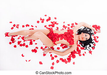 sensual woman on the floor covered in petals