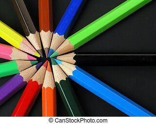 Colored Pencils in a Row on black background