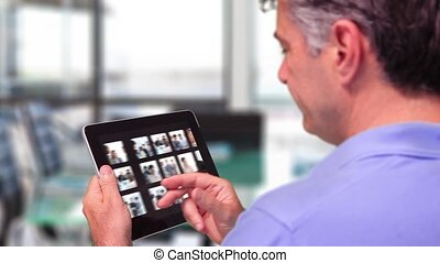 Man using tablet to view business