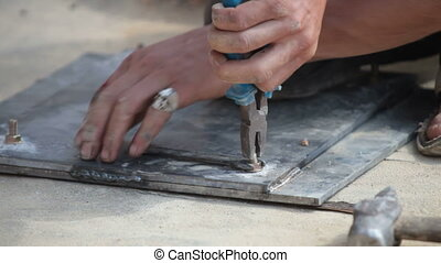 hands of builder - hands of the builder installing the...