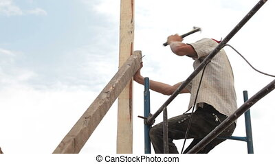 Roofing Works - Roofer working on a construction site