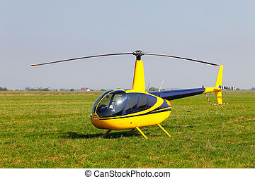 Yellow helicopter on field