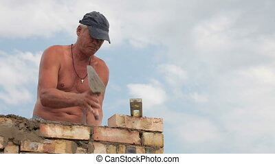 Roofing work - brickwork - Bricklayer at work with trowel on...