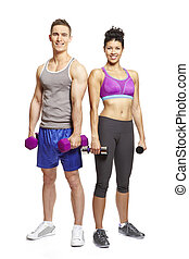 Young man and woman exercising in sports outfits on white...