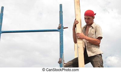 Roofer working on a construction site