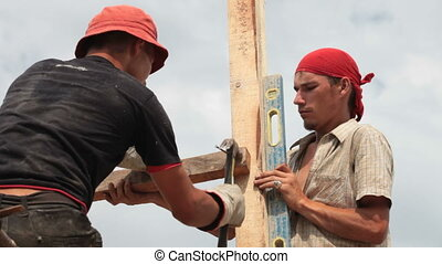 Roofers working on a construction site