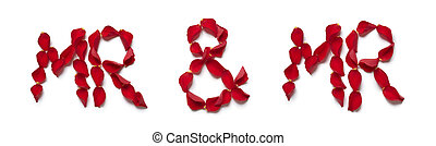 Red rose petals spelling mr and mr on white background