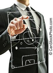 Man pointing at football field on a virtual screen to...