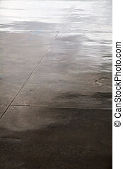 Wet Concrete Floor - High angle vertical view of a wet...