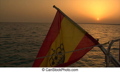 spanish flag at sundown