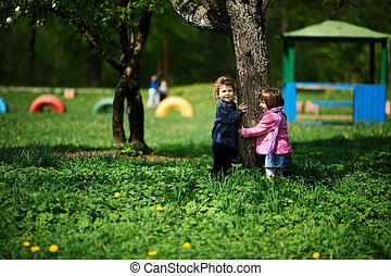 little boy and girl on playground