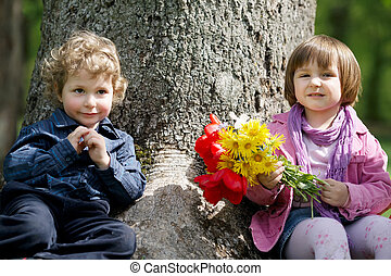 little cute boy and girl on date