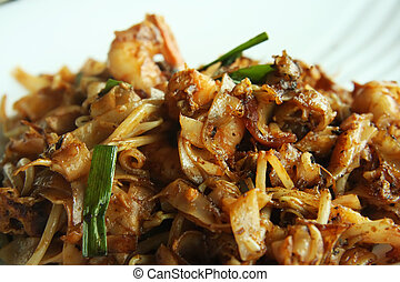 Spicy fried noodles - Spicy fried chinese flat rice noodles...