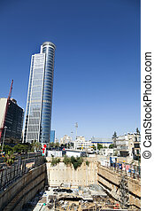 Construction Site and Skyscraper - Wide-angle view of a...