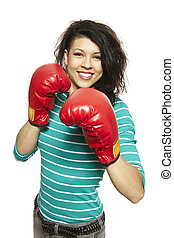 Young woman wearing boxing gloves smiling on white...