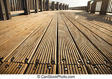 Deck Path - A wooden deck footpath in the sunlight,...