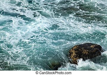 Gushing Sea - Gushing water with foaming waves smashing...