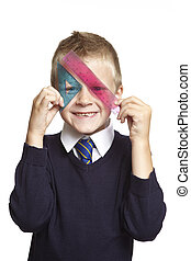 8 year old school boy with blue set square and pink ruler...