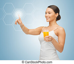 woman with glass of juice and virtual screen - woman holding...