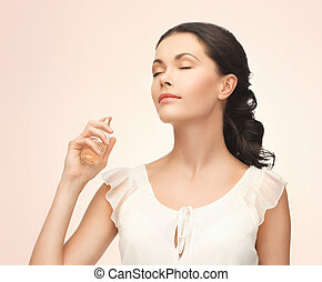 woman spraying perfume on her neck - picture of beautiful...