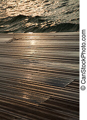 Wet Wooden Deck & Sea - A wooden deck completely soaked wet...