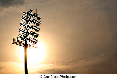 Stadium Floodlight at setting sun with selective focus