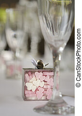 Candy heart shapes treat on wedding banquet table