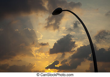 Street Lamp Silhouette & Setting Sun - Low angle shot of a...