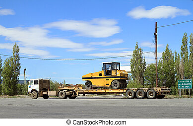 Transportation of Heavy Machinery - A parked Semi-Trailer...