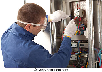 Electrician checking the energy meter - Electrician checking...