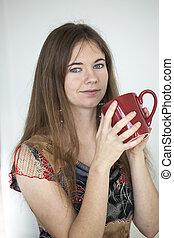 Young Woman with Beautiful Green Eyes with Red Coffee Cup -...