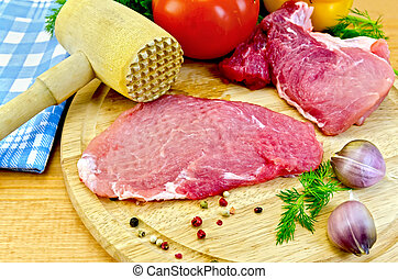 Meat batted with a hammer and vegetables