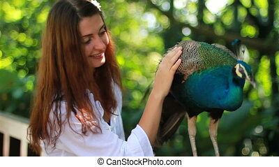 wild park with girl and peacock