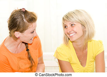 Two happy friends talking - Two happy female friends talking...